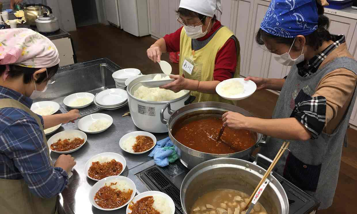 Volunteers prepare meals at a children's cafeteria in Kawaguchi, Saitama prefecture, Japan. Photograph: Justin McCurry for the Guardian